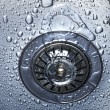 Water and droplets in sink — Stock Photo #35434213