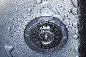 Water and droplets in sink — Stock Photo