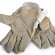 Dirty and well-worn pair of canvas and leather work gloves on wh — Stock Photo #35490875