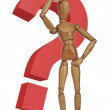 Wooden dummy with a red question mark — Stock Photo