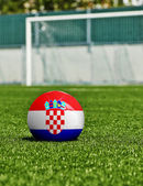 Soccer Ball with Croatia Flag on the grass in stadium — Stock Photo