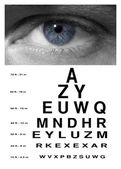 Man eye with test vision chart close up — Stock Photo