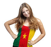 Young Woman with long curly hair and a t-shirt of Cameroon — Stock Photo