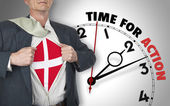 Businessman showing shirt with flag from Denmark suit against cl — Stock Photo