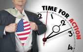 Businessman showing shirt with flag from USA suit against clock — Stock Photo