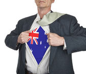 Businessman showing Australia flag superhero suit underneath his — Stock Photo