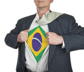 Businessman showing brazil flag superhero suit underneath his sh — Stock Photo