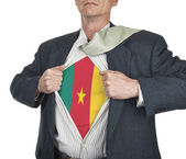 Businessman showing Cameroon flag superhero suit underneath his  — Stock Photo