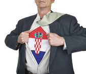 Businessman showing Croatia flag superhero suit underneath his s — Stock Photo