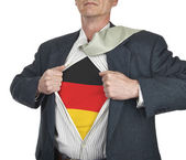 Businessman showing Germany flag superhero suit underneath his s — Stock Photo