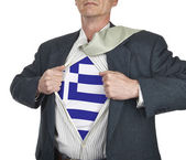Businessman showing Greece flag superhero suit underneath his sh — Stock Photo