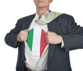 Businessman showing Italy flag superhero suit underneath his shi — Stock Photo