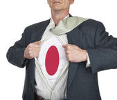 Businessman showing Japan flag superhero suit underneath his shi — Stock Photo