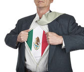 Businessman showing Mexico flag superhero suit underneath his sh — Stock Photo