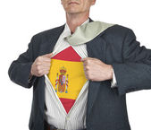Businessman showing Spain flag superhero suit underneath his shi — Stock Photo