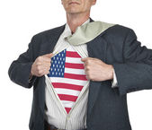 Businessman showing USA flag superhero suit underneath his shirt — Stock Photo