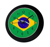 Black clock with flag of Brazil on wall  — 图库照片