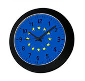 Black clock with flag of Europe on wall  — Stock Photo