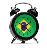 Old style alarm clock with the flag of Brazil — Stock Photo