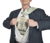 Businessman showing twenty dollar bill superhero suit underneath — Stock Photo