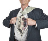 Businessman showing fifty dollar bill superhero suit underneath  — Stock Photo