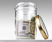 US dollars bank notes in a glass opened jar — Stock Photo
