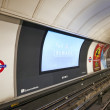 Inside view of London underground and his advertising — Stock Photo #47828371