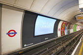Inside view of London underground and his advertising — Stock Photo