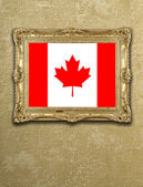 Flag from Canada exposition in gold frame — Stock Photo