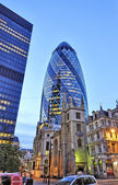 The modern glass buildings of the Swiss Re Gherkin — Stock Photo