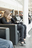Young girl waiting for her planne in airport — Stock Photo