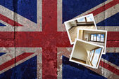 Grunge flagged UK background with renovated home on Instant fram — Stock Photo