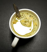 Soup mug in close up on black office table — Stock Photo