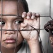 Stock Photo: Boy behind fence