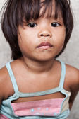 Young girl living in poverty — Stock Photo