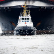 Stock Photo: Tugboat pulling freighter