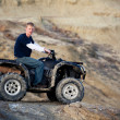 Teen on quad ATV in the hills - Foto Stock