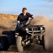 Stock Photo: Teenager riding quad