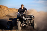 Teenager riding quad — Stock Photo