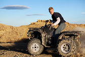 Quad - teen driving four wheeler — Stock Photo
