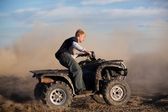 Teen riding ATV quad — Stock Photo