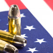 Stock Photo: Bullets over Americflag