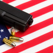 Stock Photo: Gun over americflag