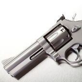 Handgun on brushed metal — Stock Photo