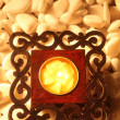 Candle with asian design on stone — Stock Photo