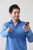 Using phone — Stockfoto