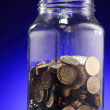 Coins in jar — Stock Photo