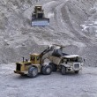 Italy, Maddaloni (Naples), stone pit with industrial vehicles at work — Stock Photo