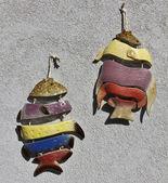 Italy, ceramic ornamental tropical fish on a wall — Stock Photo