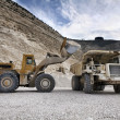 Stone pit with industrial vehicles at work - Lizenzfreies Foto